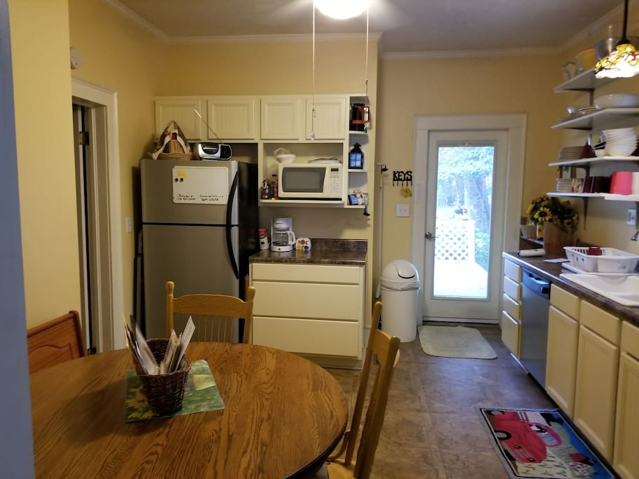 Eat-in kitchen. Double sink, full sized electric range not seen on the right.