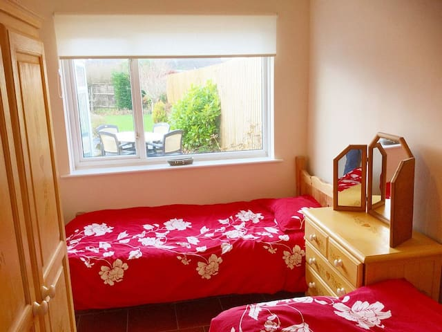 Our twin room, perfect for friends or children is equipped with full standard size single beds, overlooking the garden complete with wardrobe facilities and dressing table