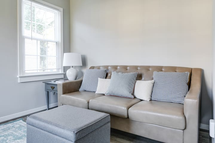 Warm and cozy leather couch in the living room space where you will make some memories in Richmond, VA.
