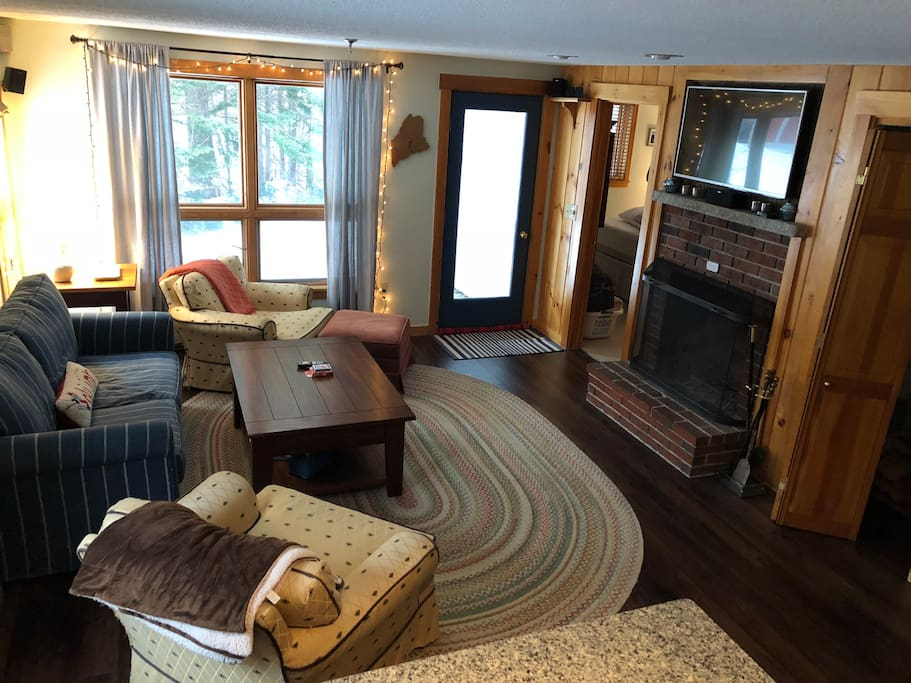 Living area with fireplace and updated flooring!