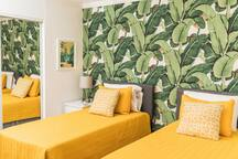 Two can share this first room with 2 twin beds and a Smart TV!