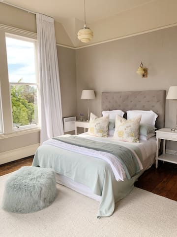 Our Maple Room has a Queen Bed, plenty of storage and views of both the Basilica and our mature front garden.