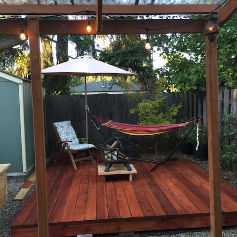 Backyard features a deck, complete with a fire pit and hammock, and a covered patio where you can relax outside rain or shine