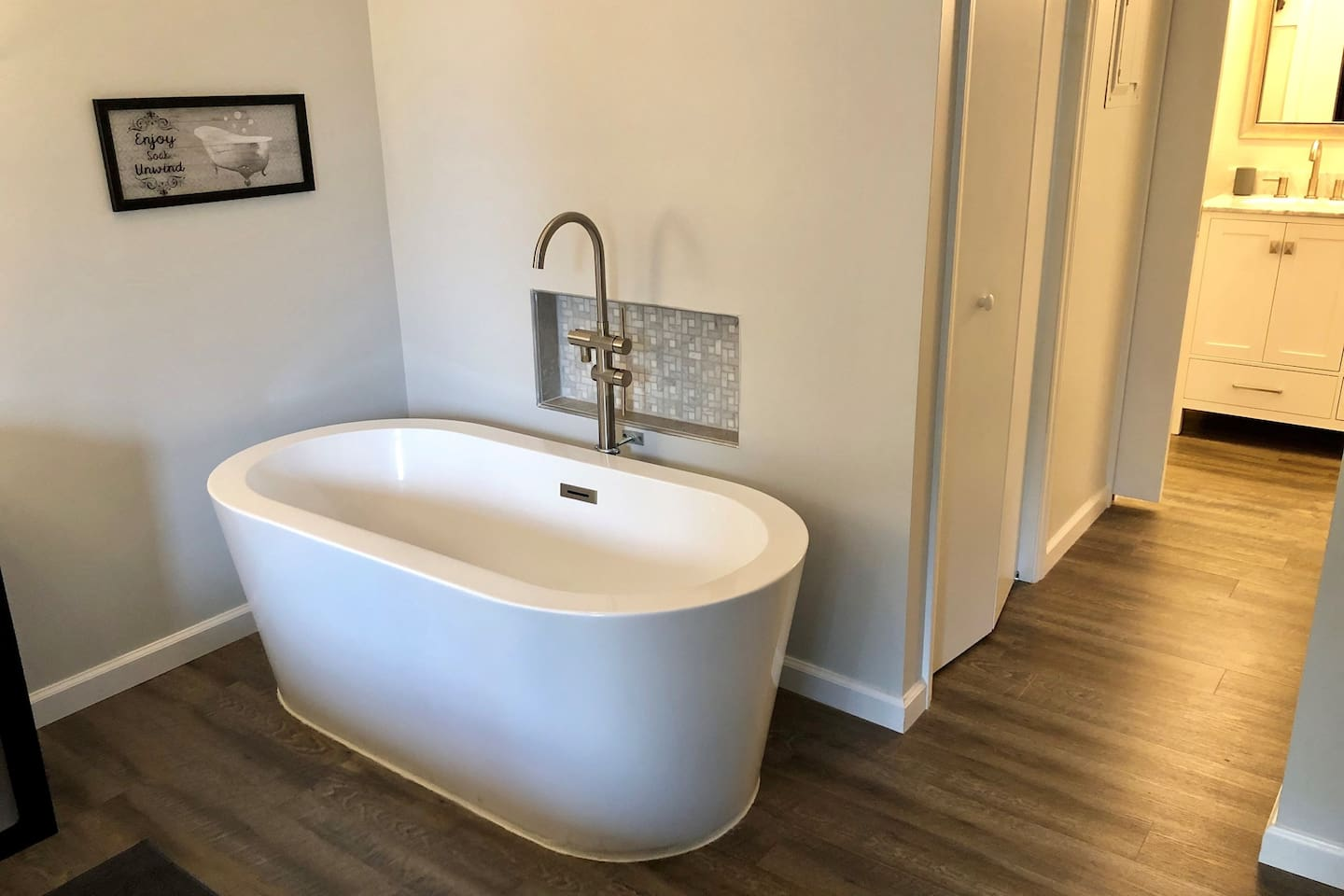 Beautiful one person soaking tub in Bedroom. Relax in peace and quiet while enjoying the fireplace or watching the Tv mounted above the fireplace.