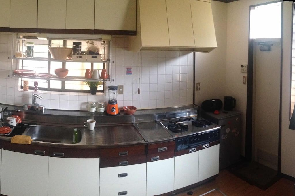 Large kitchen equipped with oven, mixer and Nespresso coffee machine