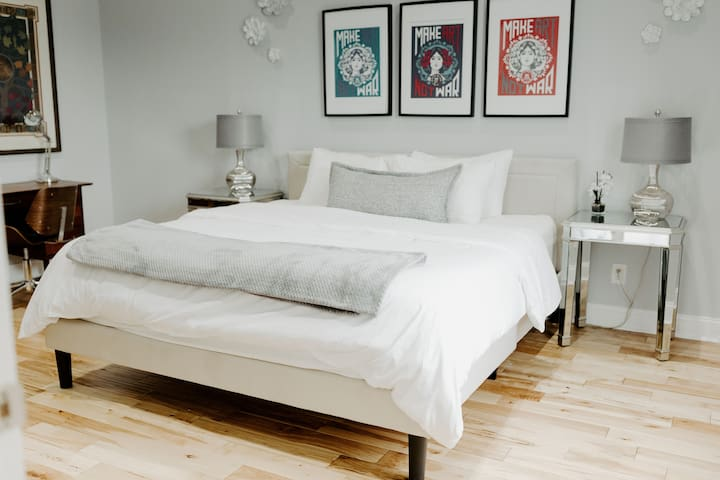 Master bedroom with a king bed and memory foam mattress