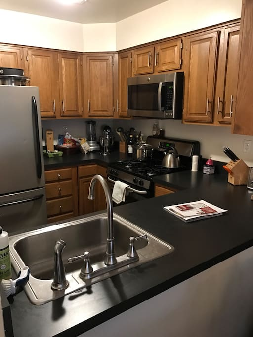 Kitchen with full size refrigerator, oven, and dishwasher
