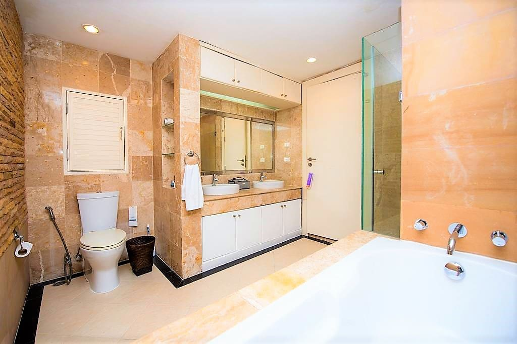 Master bath with Stand up shower and bathtub.