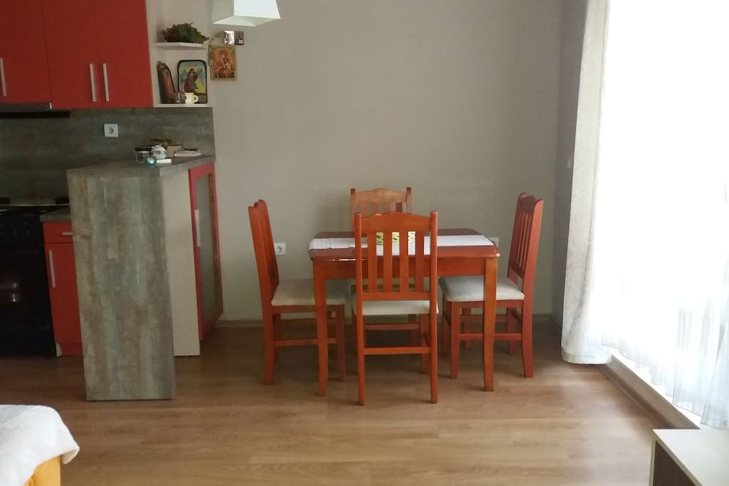 Comfortable dining table with four chairs