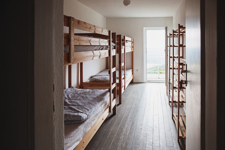 Common room with bunk beds.