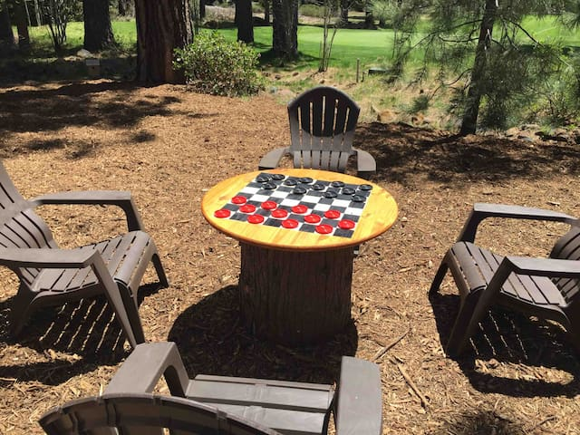 Outdoor chess/checkerboard with lounge chairs for relaxing in the sun.