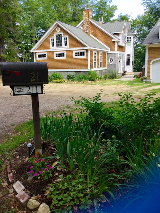Picture of our mailbox and home, park parallel to three long windows