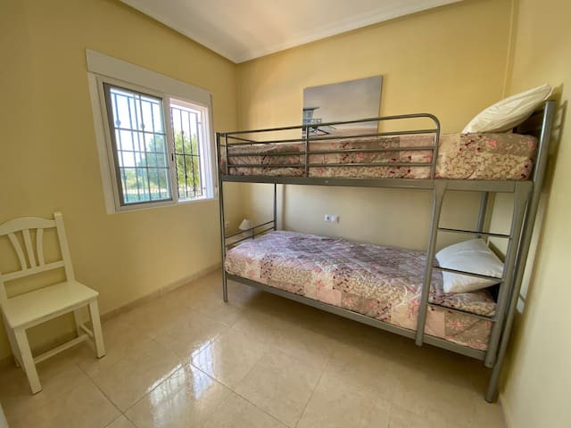 Ground floor Bedroom: 2x Trunk Bed (90cm by 200cm)  With direct view on the swimming pool