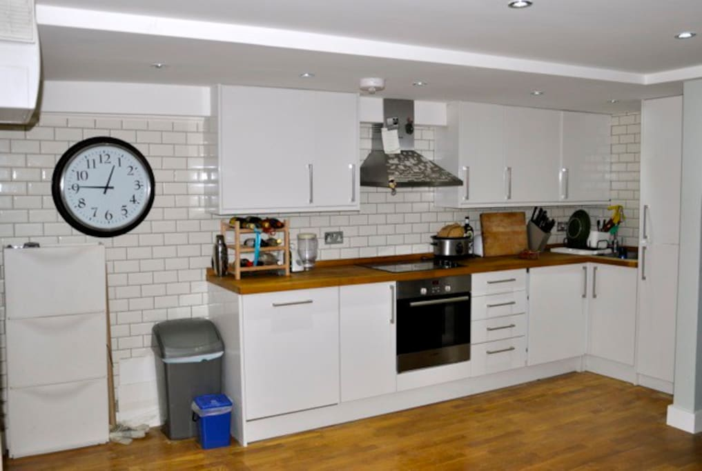 fully equipped kitchen with washer/dryer and full fridge