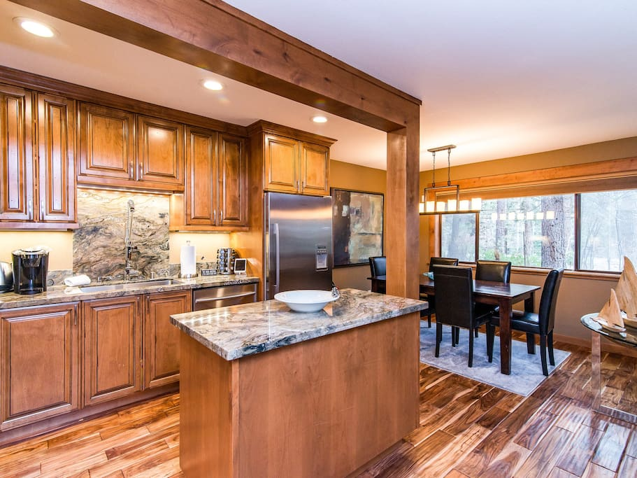 The gorgeous kitchen features plenty of prep space, including a convenient island area.