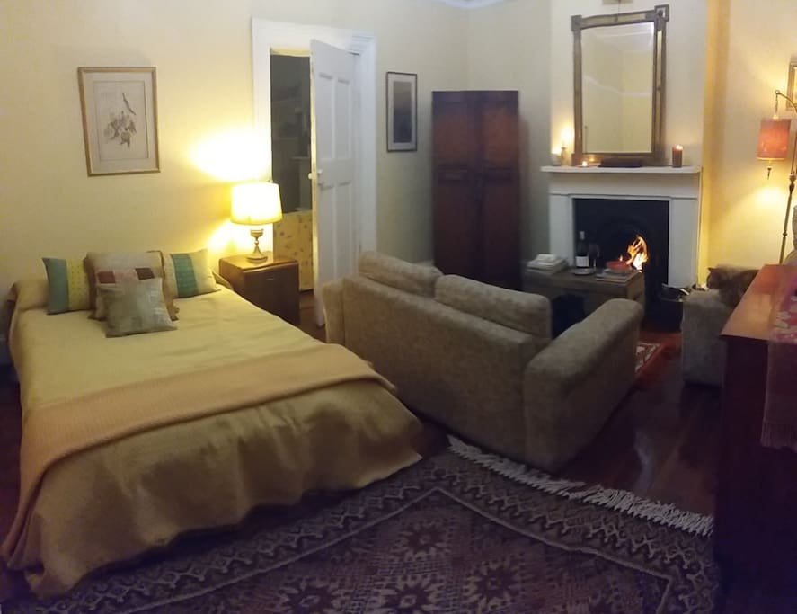 Main bedroom downstairs with its own lounge and fireplace.