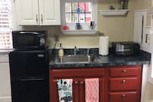 Updated photo of kitchenette with new appliances