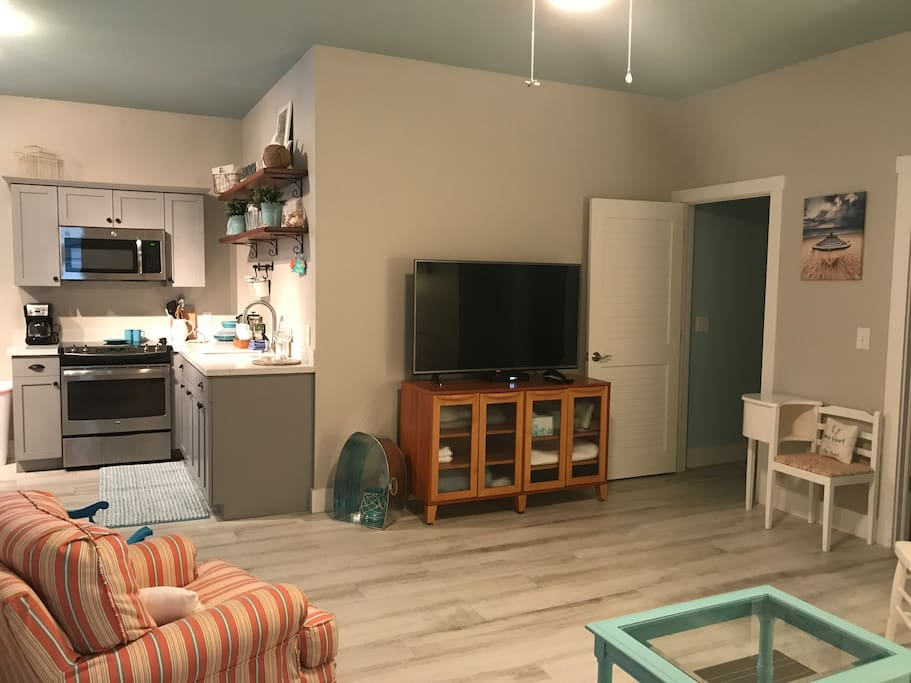Large Open Living space with eat in Kitchen, large television and extra seating for visiting guests. Cabinet full of extra towels, blankets, pillows too!