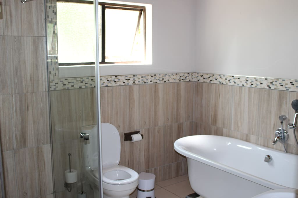 En-suite with shower, bath and toilet