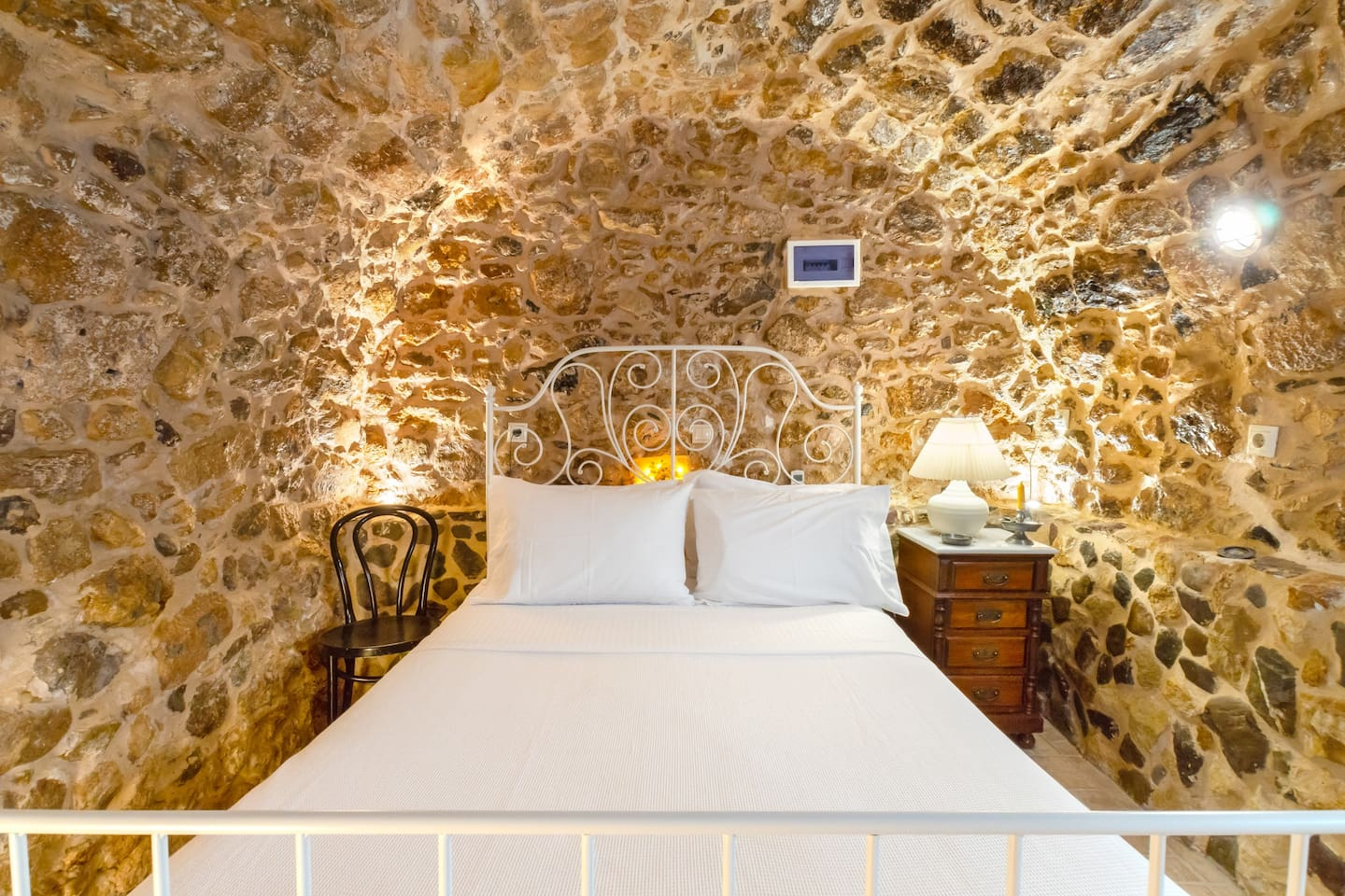 stone bedroom with wc and small kitchenette