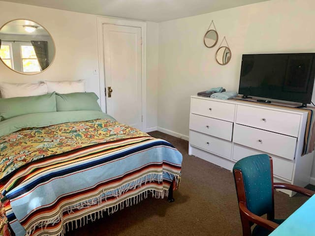 Room features double bed, vintage furniture and a smart tv. If you'd like us to put up the air mattress, we'll gladly do so. The air mattress is a double high single bed. Let us know what you need and we will gladly oblige. :)