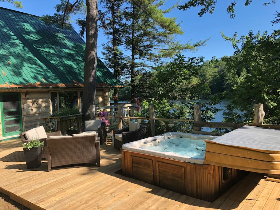 Hot tub, upper deck, glass panel railing overlooking the lake.