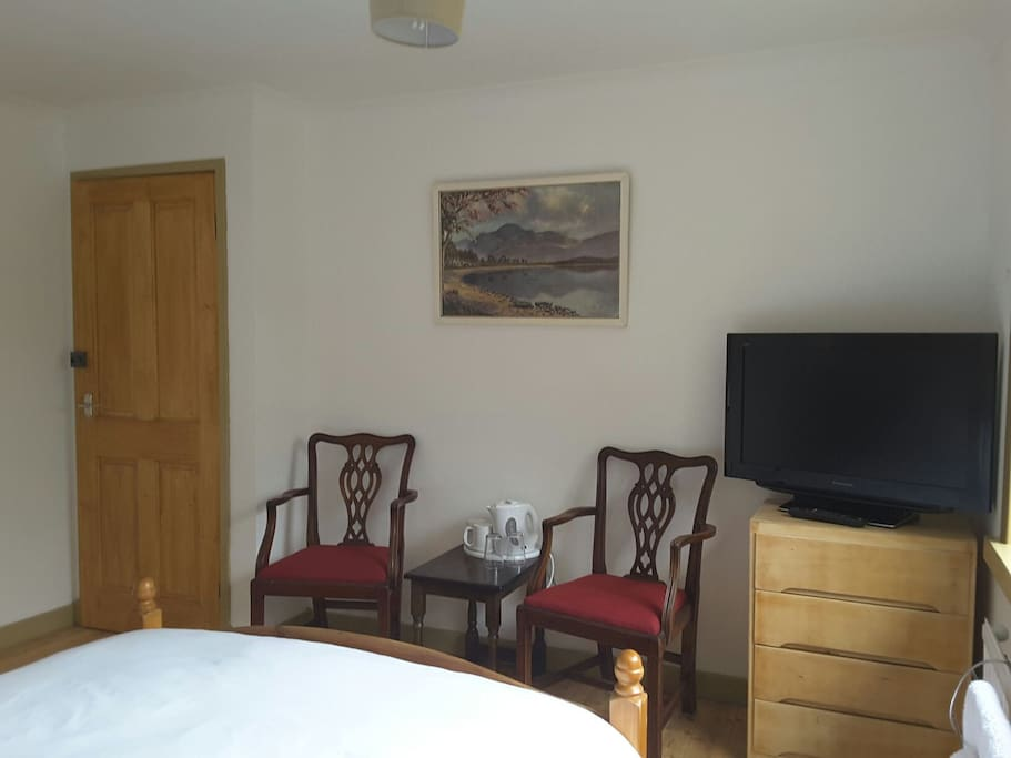 Room has a TV, seating and tea/coffee making facilities.