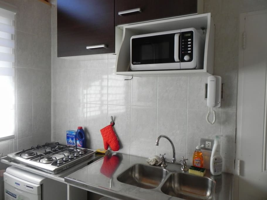 Kitchen with microwave.