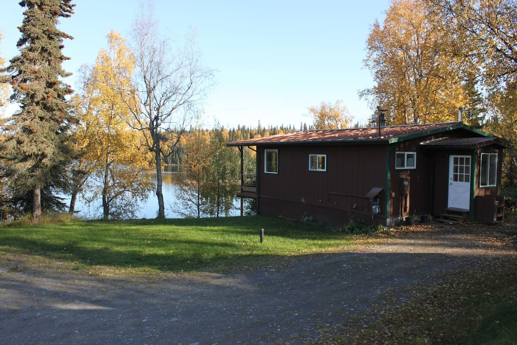 Your cozy cabin perched above a quiet Alaskan lake.