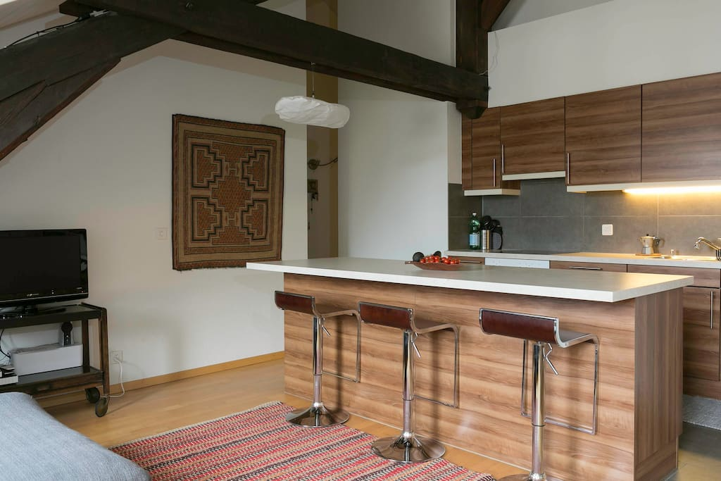 Shared open-concept kitchen with dishwasher