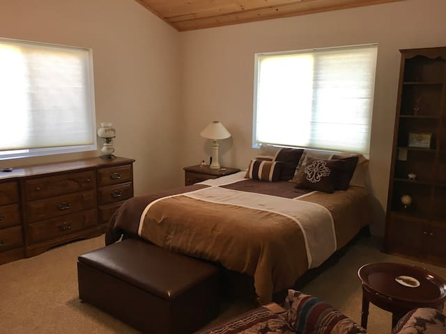 The master bedroom is large and luxurious with a ceiling fan and cedar closet.