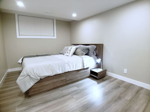 Bedroom with new Queen sized mattress