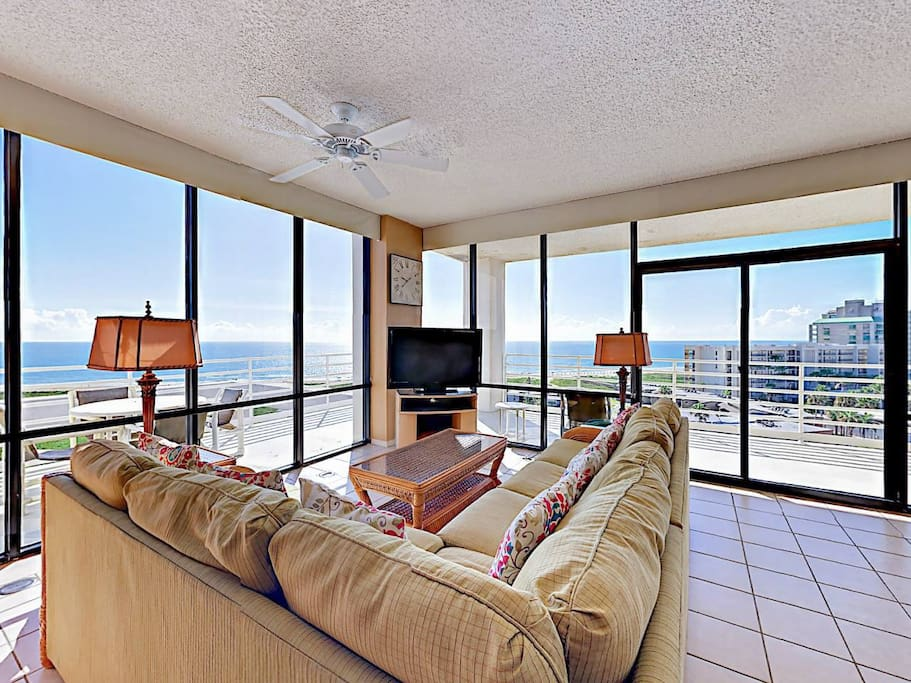 Welcome to South Padre Island! The living room features a spacious sectional couch and ocean views.