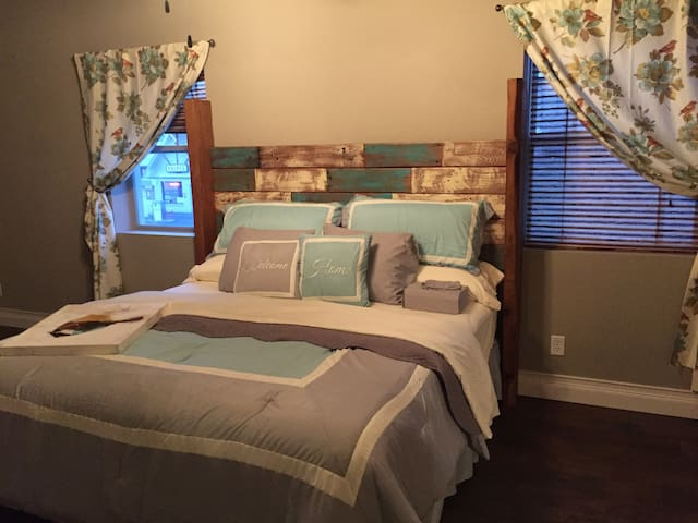 Master Bedroom 1 with custom King size barn wood headboard