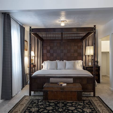 ART BEDROOM suite with king size bed and lounge area located on second level