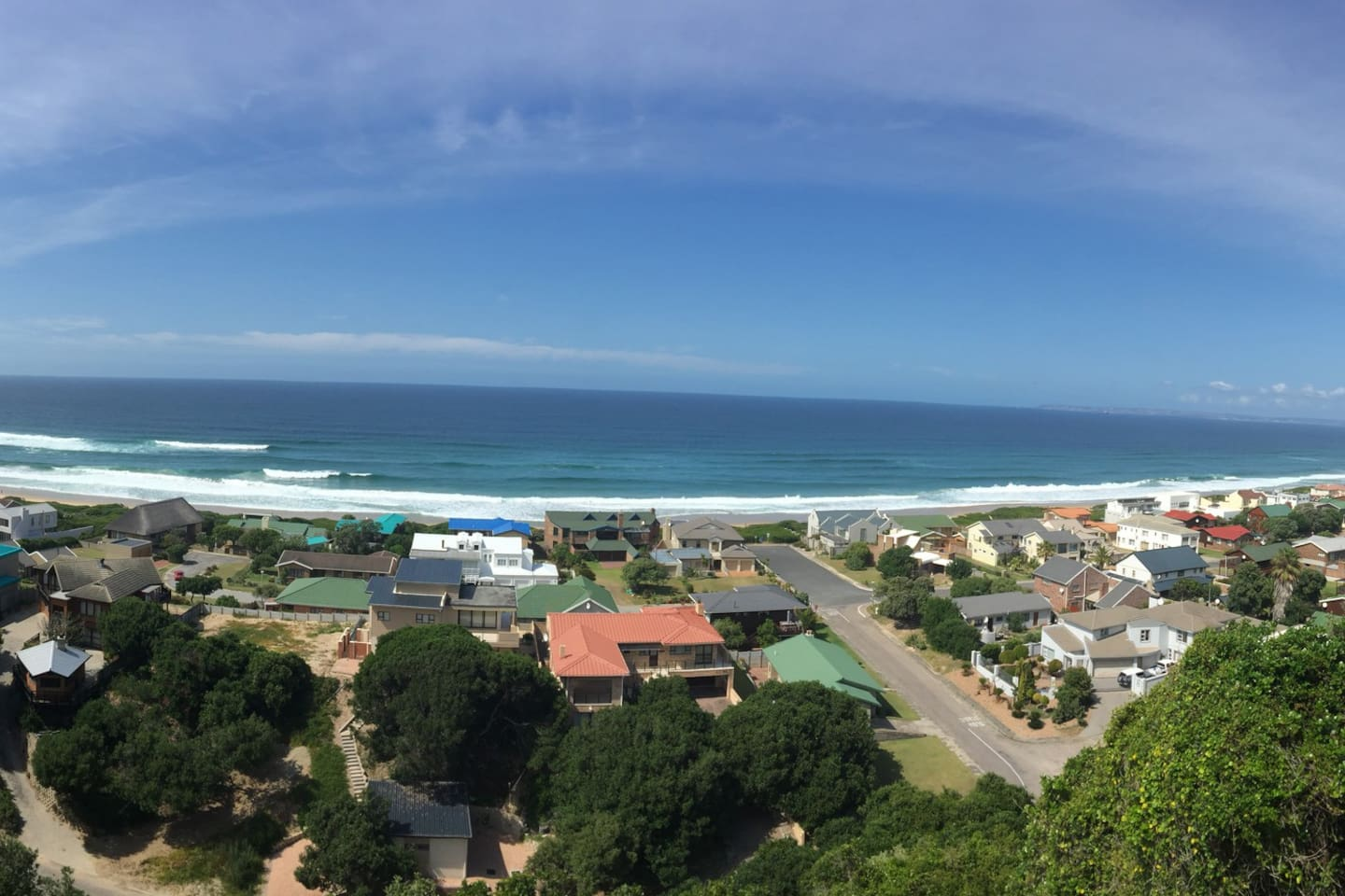 Panoramic view from the deck.  Relax and watch the dolphins surf the waves.