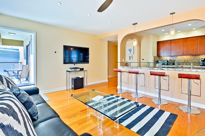 Enjoy the spacious living room with flat screen tv and balcony access.