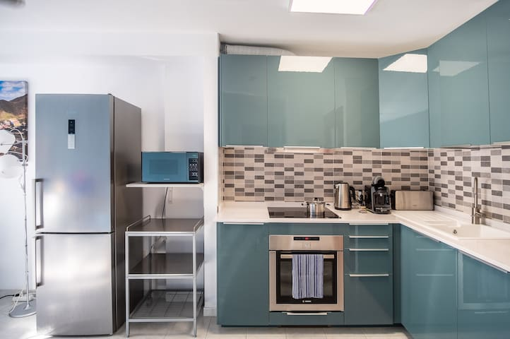 Open kitchen with all amenities and utensils