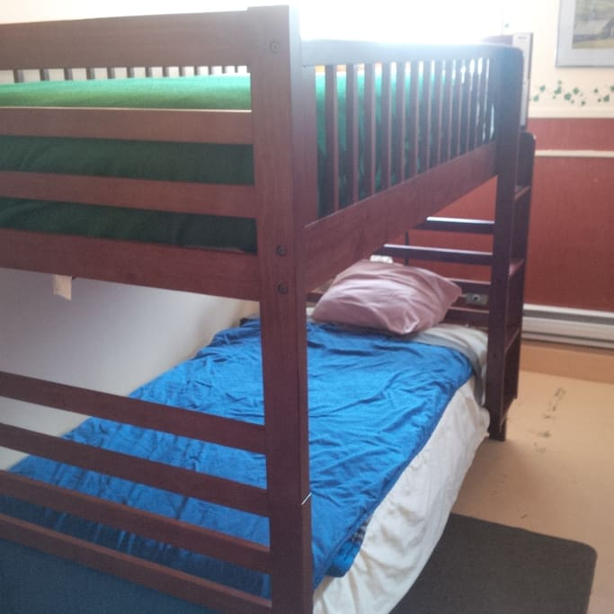 4 single beds with full private bathroom including tub