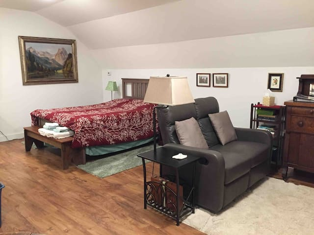 The sleeping area, & living area. The loveseat faces the TV with built-in DVD player. Numerous movies and games are in the area.