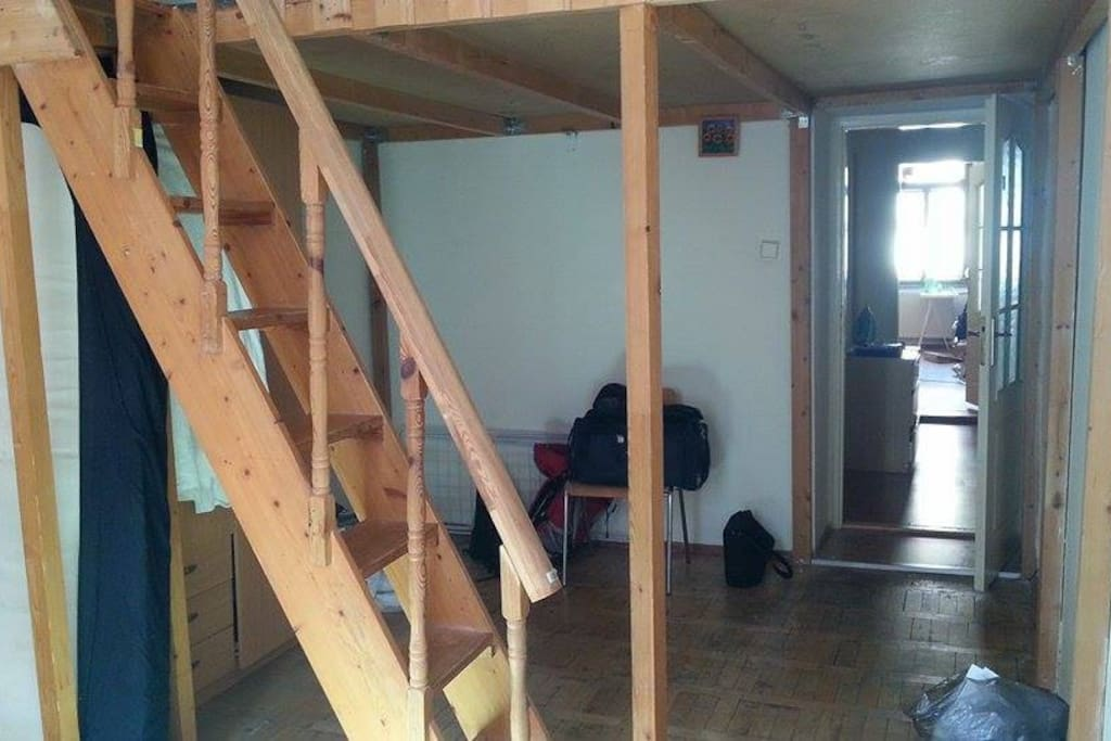 Wardrobe and open space under the loft.