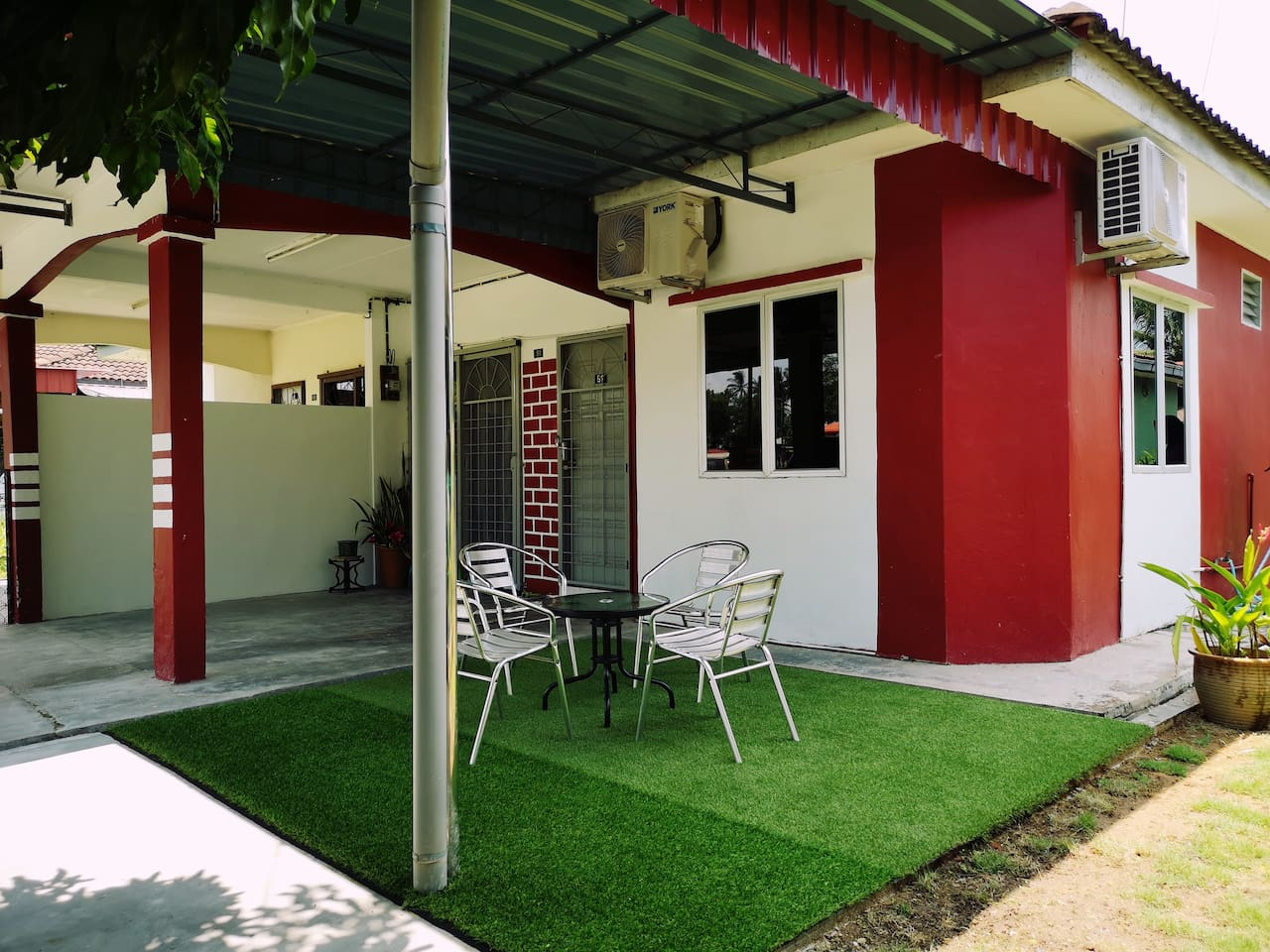 Ayang Guest House - Fully air conditioned bedroom and living room.