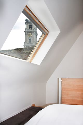 View from the bed towards the Belfry of Mons