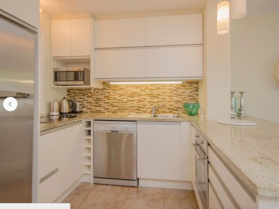 Kitchen with dishwasher/ stove , microwave , fridge, cooktop