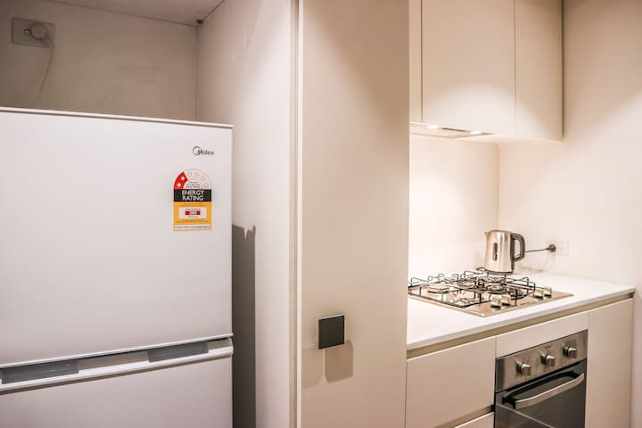 Fully equipped Kitchen (Stove, Oven, Microwave, Dishwasher, Fridge, Coffe machine Cutlery and more)