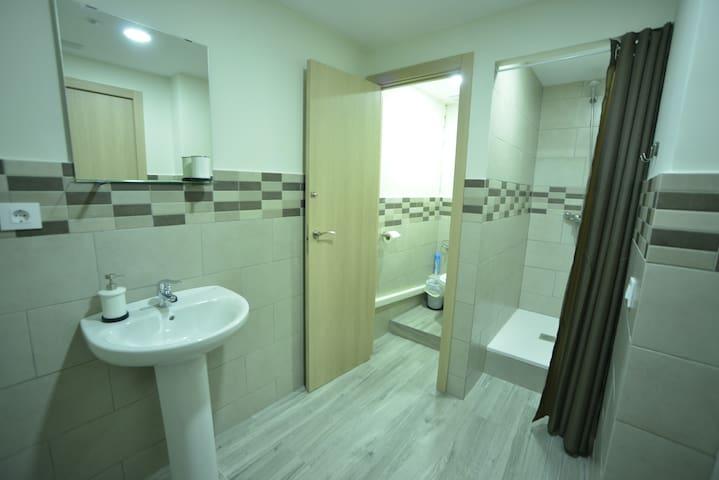 Habitacion triple con el baño compartido