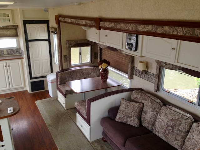 Couch and dining area fold out to beds