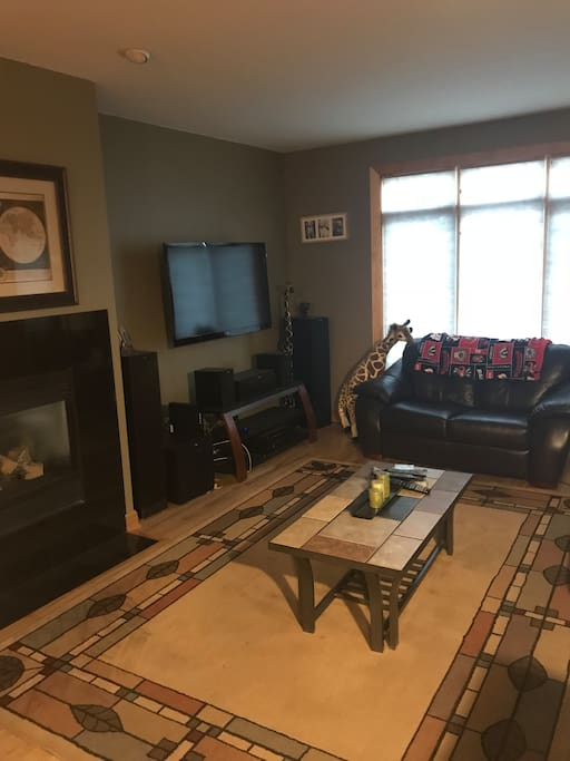 Family room with fireplace. 2 leather couches with cable TV.