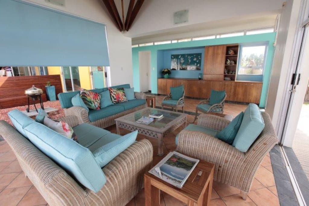 Light, sunny lounge opening to pool and sea