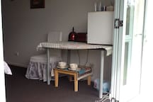 Breakfast bar has jug, toaster and small fridge.  Tea, coffee, sugar, cereals, milk and bread for toast with spreads is provided.